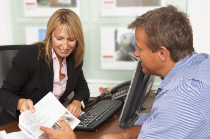 stock-photo-16941695-female-estate-discussing-property-details-with-client