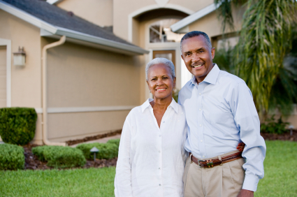 stock-photo-14082618-portrait-of-happy-african-american-couple-standing-outside-home